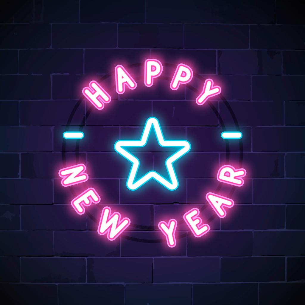 "Neon pink and blue lights that say ""Happy New Year"" with a blue star in the center."