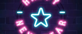 """Neon pink and blue lights that say """"Happy New Year"""" with a blue star in the center."""