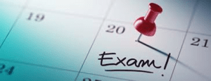 Calendar with a pin on the date of an exam