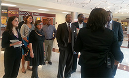 The team tours a school in Baltimore. (Tracy Sherman on the far left.)