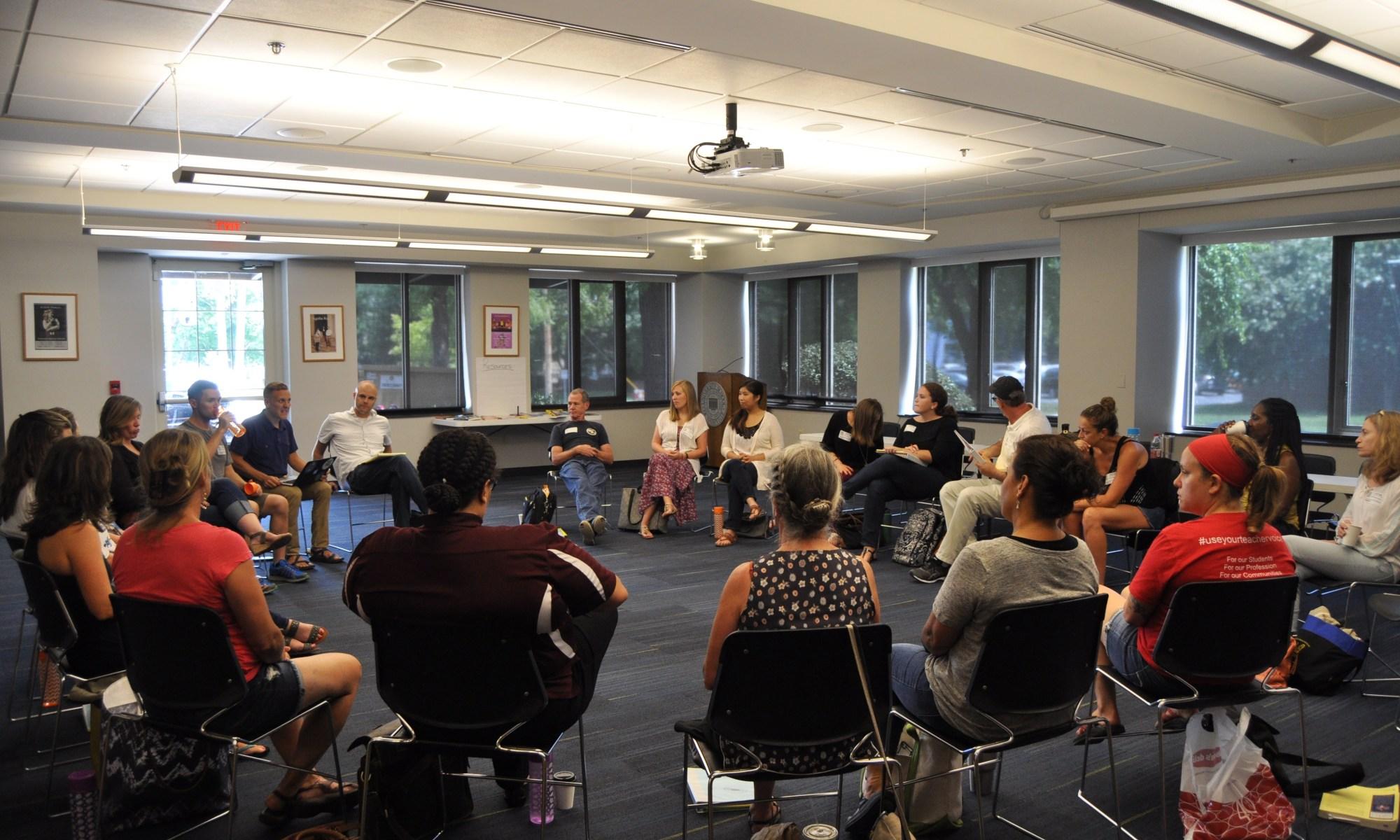 Teachers sitting in circle
