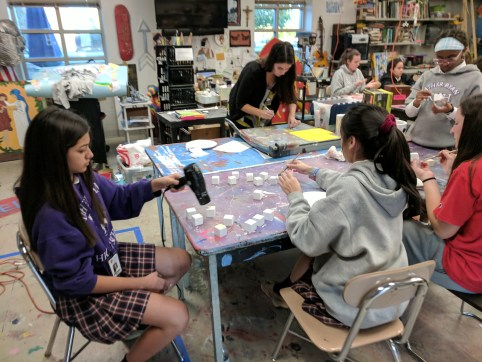 ESL students use blocks for language acquisition activity