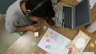 ESL student uses blocks for language acquisition activity