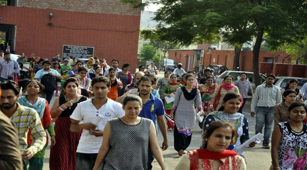 Candidates after exam of UGC at Government Model Senior Secondary School in Sector 16 of Chandigarh on Sunday, June 28 2015. Express Photo by Sahil Walia