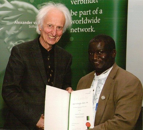 Image result for pictures of professor nok receiving award