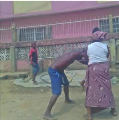 Women beat naked men