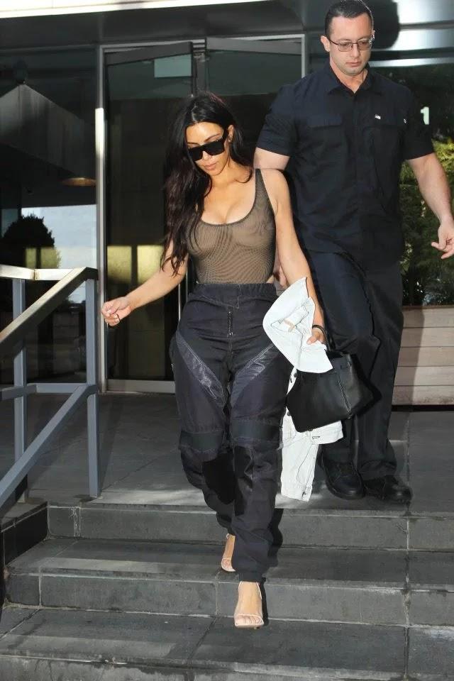 kim kardashian goes braless in yet another sheer top photos