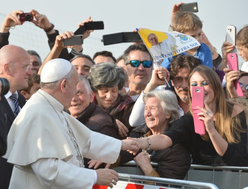 """People take pictures with their mobile phones as Pope Francis arrives to visit the Roman parish of """"Santa Maria dell'Orazione"""" in Guidonia Montecelio near Rome on March 16, 2014.  AFP PHOTO / ALBERTO PIZZOLI        (Photo credit should read ALBERTO PIZZOLI/AFP/Getty Images)"""