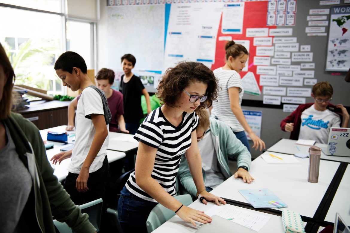 Group of students learning in classroom