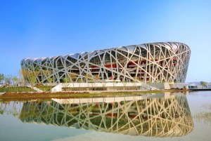 "The National Stadium is a stunning Beijing landmark. It has been nicknamed the ""bird's nest"" due to the web of twisting steel sections that form its roof. The building was designed by the Swiss architecture firm Herzog & de Meuron for use throughout the 2008 Summer Olympics and Paralympics."
