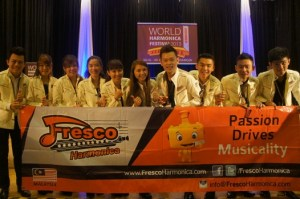 Fresco Harmonica – including its founders and UCSI alumni Evelyn Choong and Aiden Soon (sixth and seventh from left, respectively) – posing for a group shot at the World Harmonica Festival in Trossingen, Germany after netting multiple wins.