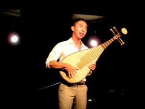 Dr Samuel Wong playing the Pipa at The Blackbox