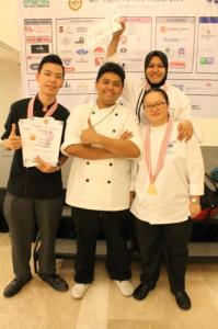 The Award-Winning KDU College Penang Team From left - Waymann Cheong, Chef Muhamad Faizal, Chef Chuah Lay Yen and Norfirdawati binti Ramli (back) with their medals.