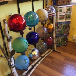 Gorgeous, colorful solar balls to light up your garden.