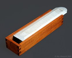 Fireplace Match Box mde from mahonany and qulted maple. This sliding top box is designed for the length of long wooden matches, but suitable for other purposes.