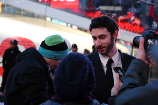 An image of Edward Sturm being interviewed after organizing a Harlem Shake Flash Mob in Times Square