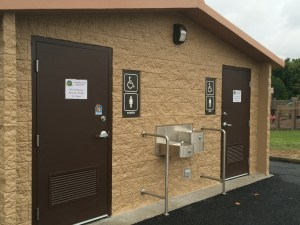 Image of building front of the new all season bathroom, including the men/womens doors and water fountain, located at Edwardsville Township Community Park