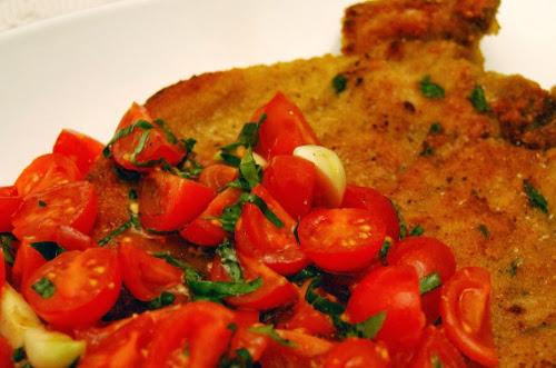 cotolette-maiale-con-dadolata-pomodori