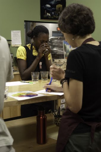 Lydia Nabulumbi and Jodi Anderson, Equal Exchange Natural Foods sales representative, during a cupping in the Equal Exchange Quality Control Lab