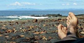 Dave's feet, a coconut, and Playa Ocotal