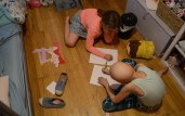 Harmony and her friend Cali Pennell draw on the floor of her bedroom.