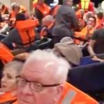 Karm video kruiisilaevalt: inimesed on koondatud suurde saali, näod on hirmul