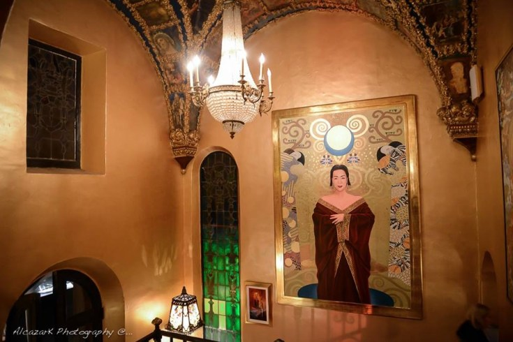 The entryway of Sue Wong's palatial estate with her Klimt inspired portrait welcomes visitors. Photo courtesy of Ken Alcazar Photography