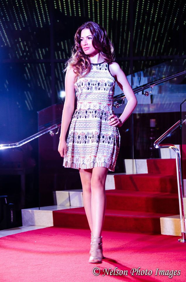 Model in a beautifully patterned fit and flare dress. Photo courtesy of Nelson Photo Images