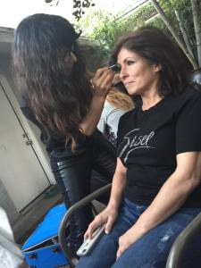 Badri applying makeup behind the scenes backstage