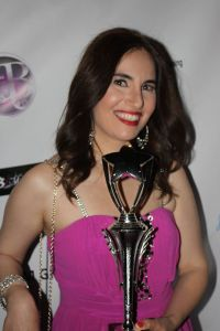 Photo of yours truly on the red carpet with my award. Hair by Drybar and makeup by Blushington. Dress by Ally Fashion and jewelry and purse by the Mitra Collection. Photo courtesy of Roland De Guzman