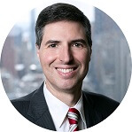 man with slight smile in business suit - defense-legal-malpractice-nyc-lawyer