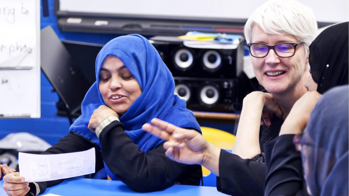 An EFA teacher and students participate in an ESOL class