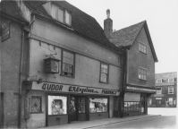 iew of shops at west end of Sun Street; south side; showing no.1 Fruiterer and Greengrocer (P.Greenall) and no.3 Pharmacy (C.A.Engelsen) and Green Dragon in the Market Place Wills' Capstan Cigarette Advertisement