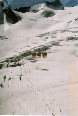 Summer skiers and the cable cars on Mount Blanc