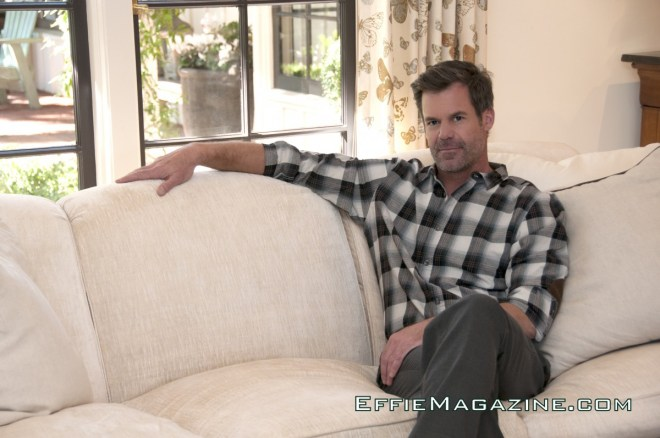 EffieMagazine.com Photo of Tuc Watkins lounging in Chicks & Blokes shirt & slacks.