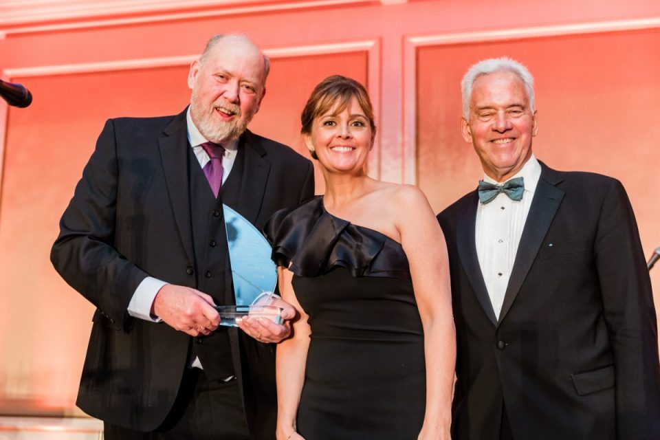 Tim, Megan and Carl accepting award