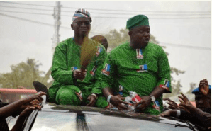 Fashola And Ambode Throw Sweets And Noodles At Poor Nigerians (Photos)