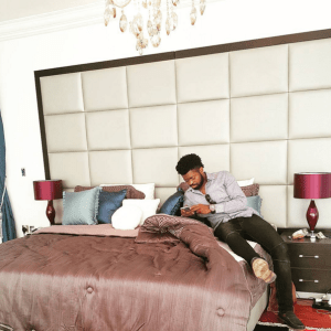 Basketmouth chilling in Linda Ikeji's bedroom (Photos)