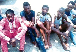 Ibrahim second left and other suspects