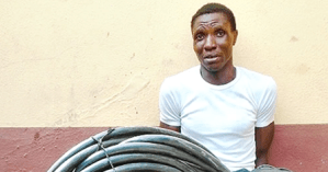 Man caught trying to steal Ambode's 'Light Up Lagos' project cable (Photo)