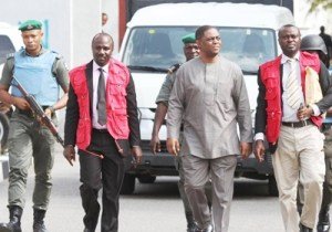 Femi Fani-Kayode flanked by EFCC officials