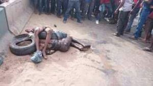 Angry mob set armed robbers ablaze