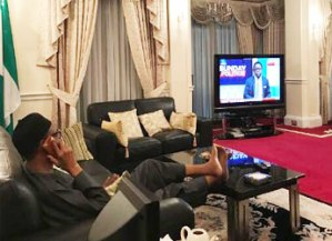 President Buhari pictured watching Channels TV in Germany! Death rumor debunked