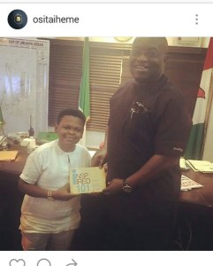 Osita Iheme presents a copy of his book to Gov. Ikpeazu