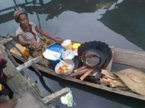 Photo of the day! Woman frying Akara in a boat