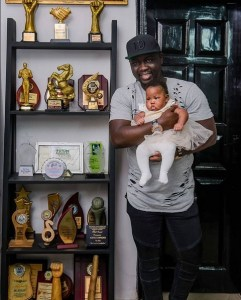 Seyi Law flaunts award plaques with daughter