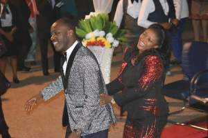 Apostle Suleiman and wife show some public display of affection as they dance together in church