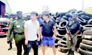 Two Chinese Nationals charged to court for importing fake tires worth 5billion naira