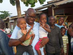 Fayose shares money to children who flocked around him during project inspection