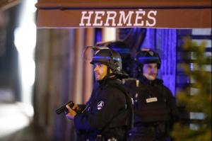 Paris police officer killed and two injured in suspected terrorist shooting